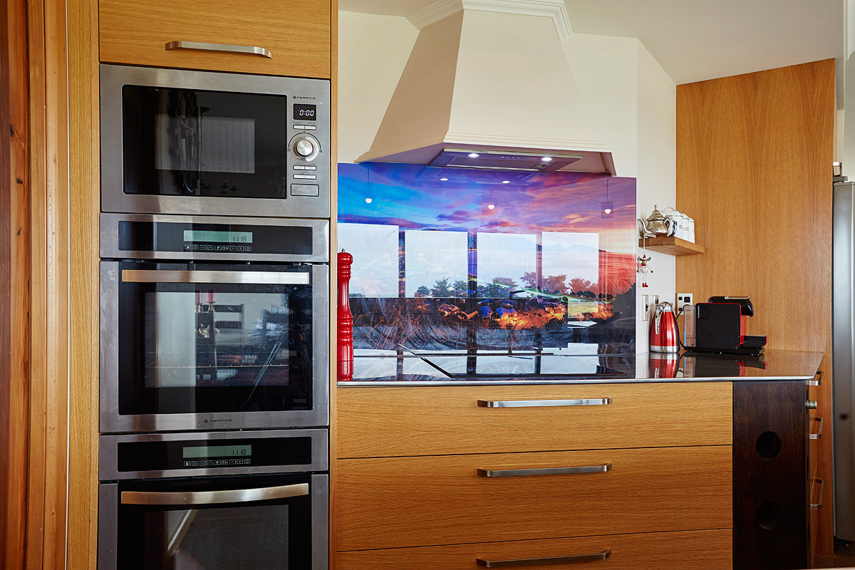 Custom kitchen with glass splashback